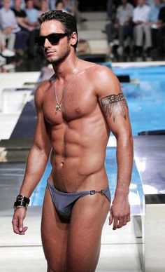 Bathing suit. An old pic of model Josh Wald. He had one of the sexiest bodies.