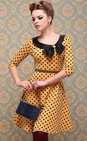 This dress is in medium and small size, yellow color, with black spots, round neck and a black ribbon, short sleeves and belt coffee with a beautiful blue bag is included   The Price   is 250.