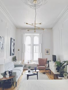 Studio apartment | shop the look: desk - coffee table - small blue table - buffet - rug - chandelier - desk chair - wing chair - triangle throw Follow Gravity Home: Blog - Instagram - Pinterest -...