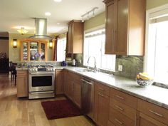 Transitional Kitchen with wood floors and birch cabinets eclectic kitchen Solid Wood Kitchen Cabinets, Solid Wood Kitchens, Wood Floor Kitchen, Best Kitchen Cabinets, Maple Cabinets, Kitchen Cabinet Remodel, Kitchen Cabinet Colors, Wood Cabinets, New Kitchen