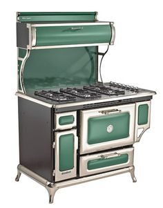 Would love this in white and nickel-plated. Victorian-style porcelain-coated iron grates and nickel-plated trim disguise a powerful 48-inch gas range.