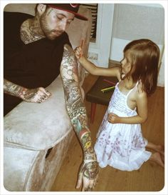 """all my tattoos will be black and white so that my kids will always have a coloring book"" so cute"