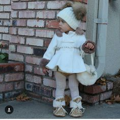 Miss Dalary is looking sweet for fall! We love how she paired cream and faux furs! Our faux fur purses are now in stock and ready to ship to your tiny fashionistas!