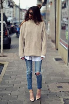 winter outfit idea - sand colored oversized sweater layered over a button up blouse, worn with ripped skinny jeans + t-strap nude pointy-toe heels