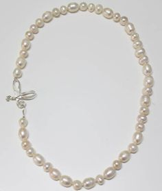 Freshwater pearls necklace with a sterling silver bow