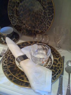 Ralph Lauren dinner setting... Love the leopard chargers.