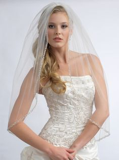 Julia Crystal Beaded Veil features a delicately scattered pattern of alternating rhinestones, bugle beads and tiny sequins. This beaded edge is approximately 1/4 inch wide along the veil.