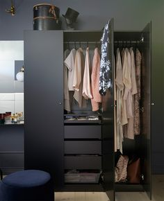 IKEA has lots of black wardrobe closets like this PAX wardrobe with a black-brown frame, TANEM black hinged doors and black-brown interior drawers. The wardrobe closet can be easily adapated to your needs with dividers, baskets and accessories.