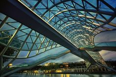 The Bridge of Peace is a new bridge, built on 2010 in the Rike district of Tbilisi, Georgia. It has been designed by an Italian architect, Michele De Lucchi and is a pedestrian bridge that straddles the Mtkvari river, connecting the Old Tbilisi district with the new buildings.  Photo by Roland Shainidze