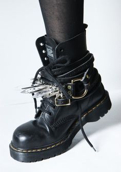 Buckled and spiked Dr. Martens.