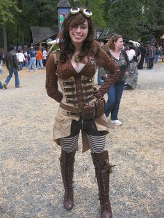 She has a damsel in distress corset! OMG I'm so jealous! Love the tall boots and striped tights! #provestra