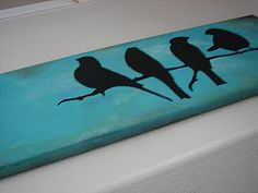 Paint top horizontal strip of fence (outdoor paint / shade of teal or blue) - with black or brown, paint birds sitting on a branch on just parts of the strip. Nice decorative touch to the fence.