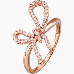 rose gold and diamond bow ring.