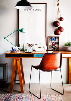 Rustic workspace with industrial lighting and leather chair