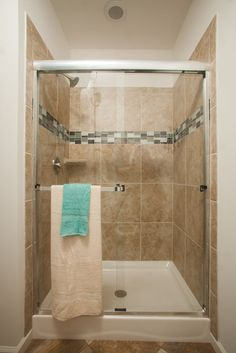 Our Augustine  RL510A  - Manorwood Cape Home Master Bathroom features this great walk in ceramic tile shower with mosaic insert accent!