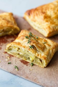 Potato Leek Cornish Pastry - a delicious classic English pastry made easy with store-bought puff pastry. The potato leek filling is combined with fresh thyme, sharp cheddar cheese, and cream to create a comforting, indulgent, and delicious main course! #leek #potato #pastry #thyme #pasty #abeautifulplate
