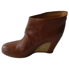 Maison Martin Margiela Tan Leather Ankle Boots with Wood and Studs 39 | From a collection of rare vintage shoes at https://www.1stdibs.com/fashion/accessories/shoes/