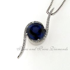 """Centre stone is a round cut tanzanite with 39 x GH/SI round brilliant cut diamonds micro set in a modern """"twisty"""" white gold setting Diamond Pendant, Centre, Sapphire, Diamonds, White Gold, Pendants, Stone, Rings, Modern"""