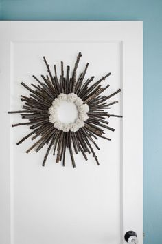 Make a twig and pom pom starburst wreath— It's practically free! Make a twig and pom pom starburst wreath— It's practically free! Twig Crafts, Diy Arts And Crafts, Xmas Crafts, Christmas Projects, Home Crafts, Christmas Wreaths, Stick Wreath, Twig Wreath, Thanksgiving Decorations