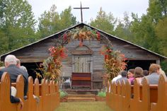 Beautiful Archway for a Fall Wedding! Decorated with foliage and fall flowers!