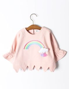 Brighten up your day with this lovely, super cute and comfy 3D Rainbow Jumper. Made from 100% cotton, this pretty girl's top has circular flounced elbow-length sleeves, triangular-cut hemline, jewel neckline and key-hole button fastening to the reverse. A stitched 3D rainbow and cloud brooch with tassel embellishments in pastel colours complete the fun and playful look. The perfect outfit centrepiece for your little one's wardrobe this Spring. This sweater works well matched with the ...
