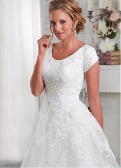 Totally Modest - Jane - Elegant lace placed asymmetrically creates movement through this modest gown. The lace drapes over the scoop neckline bodice and through the natural waistband and onto the A-line skirt and train. White Lace Wedding Dress, Modest Wedding Gowns, Elegant Wedding Dress, Dream Wedding Dresses, Modest Dresses, Pretty Dresses, Bridal Dresses, Prom Dresses, Dream Dress
