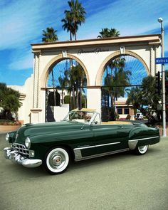 A Cadillac 1948 in front of Paramount Pictures famous gated entrance on Melrose Avenue in Hollywood.