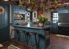 The modern country kitchen has been updated with a Sub-Zero refrigerator and a Viking gas stove, yet still retains a period look with soapstone sinks and cabinetry made from hand-planed panels.