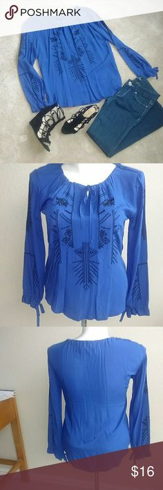 Blue Long Sleeve Blouse NWOT - Blue blouse with black embroidered detail. Long sleeve shirt with ties at wrists and neckline. Lightweight. 100% Cotton. Size Small. Tops Blouses