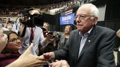 """""""Tonight we have made a little bit of history,"""" the white-haired Sanders said at a podium positioned between Wisconsin and United States flags at the outset of his hourlong speech before a boisterous crowd. """"Tonight, we have more people at any meeting for a candidate of president of the United States than any other candidate."""""""