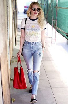 Emma Roberts keeps things simple in a pair of ballerina flats + distressed denim
