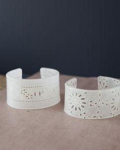 Shrinky Dink bracelets with a lace pattern. cool!
