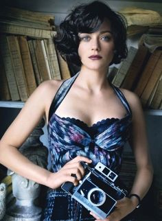 Marion Cotillard photographed in Louis Vuitton by Mario Testino for Vogue June 2010.  I adore everything about this shoot--hair, costume, poses and the vintage cameras are the clincher. Yes, I'm posting every shot.