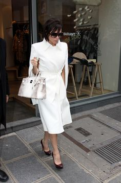 The posh designer reportedly owns about 100 Birkins, estimated to be valued at some $2 million. Although since she introduced her own line of handbags we've only seen Mrs. Beckham tote her oversize version for traveling, we're still fond of her coordinated Birkin-featured ensembles, especially when she carried the rare Himalayan style (another of which recently sold for $185,000 at auction). - Photo: KCSPresse/Splash News