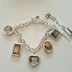 Premier designs picture perfect charm bracelet Silver plated toggle bracele. It is 7 1/4 in long. Has 5 charms to insert you favorite pictures of loved ones. Premier designs  Jewelry Bracelets
