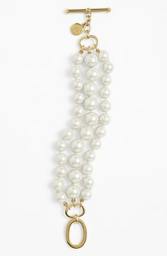 This beautiful Ralph Lauren three-row faux pearl bracelet is elegant and timeless.
