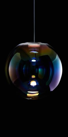 The Iris pendant lamp appears like a permanent, iridescent soap bubble. by neo craft