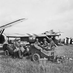 THE BRITISH AIRBORNE DIVISION AT ARNHEM AND OOSTERBEEK IN HOLLAND. The first two gliders to touch down, their wing tips interlocked after colliding on landing. In the foreground are the Headquarters Artillery Group. Nearly all the vehicles of the 1st Airlanding Reconnaissance Squadron (whose task it was to lead the race for the road and railway bridges) were lost on route as several gliders broke their tow ropes.