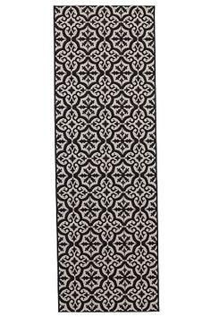 Glatvævet tæppe med smukt kakkelmønster. Af 100% polypropylen. Støvsugning/skumvask.