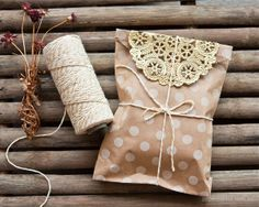 Papercookie — Lovely packaging | twine, doily, and polka-dotted paper bag