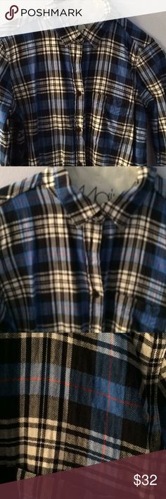 Boy 00 jcrew button down spring, fall shirt. The shirt has white, red, royal blue and it's hard to tell if it's navy or black. I think it's navy . It is a boy shirt oo from jcrew. Its in good shape just wrinkled. J. Crew Tops Button Down Shirts