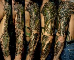 Man Left Sleeve Green Ink Biomechanical Tattoo