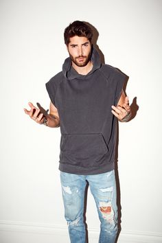 Nick Bateman Talks Being the New Face of GlamGlow and More: We had him walk us through his entire low-maintenance routine and show us some bow staff for good measure (wink.) More abs below. -- Grey sleeveless men's hooded sweatshirt | coveteur.com