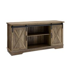 Walker Edison Modern Farmhouse Wood TV Stand- Rustic Oak at Lowe's. This TV stand will give your living room a charming country feel, while also providing plenty of storage space for your electronics and décor. Barn Door Tv Stand, Barn Door Console, Rustic Tv Console, Modern Farmhouse Design, Rustic Farmhouse, Farmhouse Style, Barn Style Doors, Wood Grain Texture, Reclaimed Barn Wood