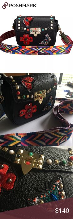 """Just in! """"Valentina"""" Rockstud Guitar Strap Bag Just in! """"Valentina"""" Rockstud Rolling Embroidered Guitar Strap Bag in Black • Brand new/untagged. Red & blue/green flowers & butterflies with colorful studded hardware. 1st one Sold immediately, so purchased another. Super cute & very much like the designer bag for a fraction of the price! 2017 Runway Trend! Genuine leather & detachable guitar strap! You'll get a ton of compliments on this beauty! Picture is of actual item. Open to reasonable…"""
