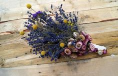 "A bouquet for a bride (bridesmaid) made of dried flowers is a beautiful and very fashionable addition to your wedding arrangement.The bouquet I offer you is made from these species of flowers:--lavender--dried billy buttons bunch-- strawflower--limonium (Statice, Sea Lavender, Marsh-rosemary--baby's breathDimensions:Height:50cm/20""Radius:26cm/10""****100% handmade****I can do bigger, with a bow or a few more ona request.Looking for something similiar:"