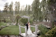 Matt Shumate Photography at Beacon Hill summer wedding bride and groom romantic kiss portrait on bridge
