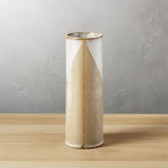Shop triangle vase. Handmade vessel pairs earthy brown clay with modern white graphics for a fresh twist on the trendy chevron pattern. Elegant cylindrical tower rises to almost a foot tall in a textured, reactive glaze that makes each piece unique.