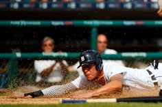 Home-field hero: Detroit Tigers center fielder JaCoby Jones dives in safe at home with the winning run against the Chicago White Sox on Aug. 31 at Comerica Park in Detroit. Detroit Baseball, Detroit Tigers, Baseball Season, Baseball Players, Chicago White Sox, Man Crush, Diving, Mlb, Crushes