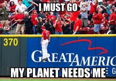 A great capture of Cincinnati Reds right fielder Jay Bruce going airborne for Milwaukee's Carlos Gomez home run hit.